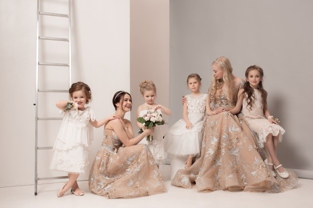 little-pretty-girls-with-flowers-dressed-wedding-dresses_155003-14900